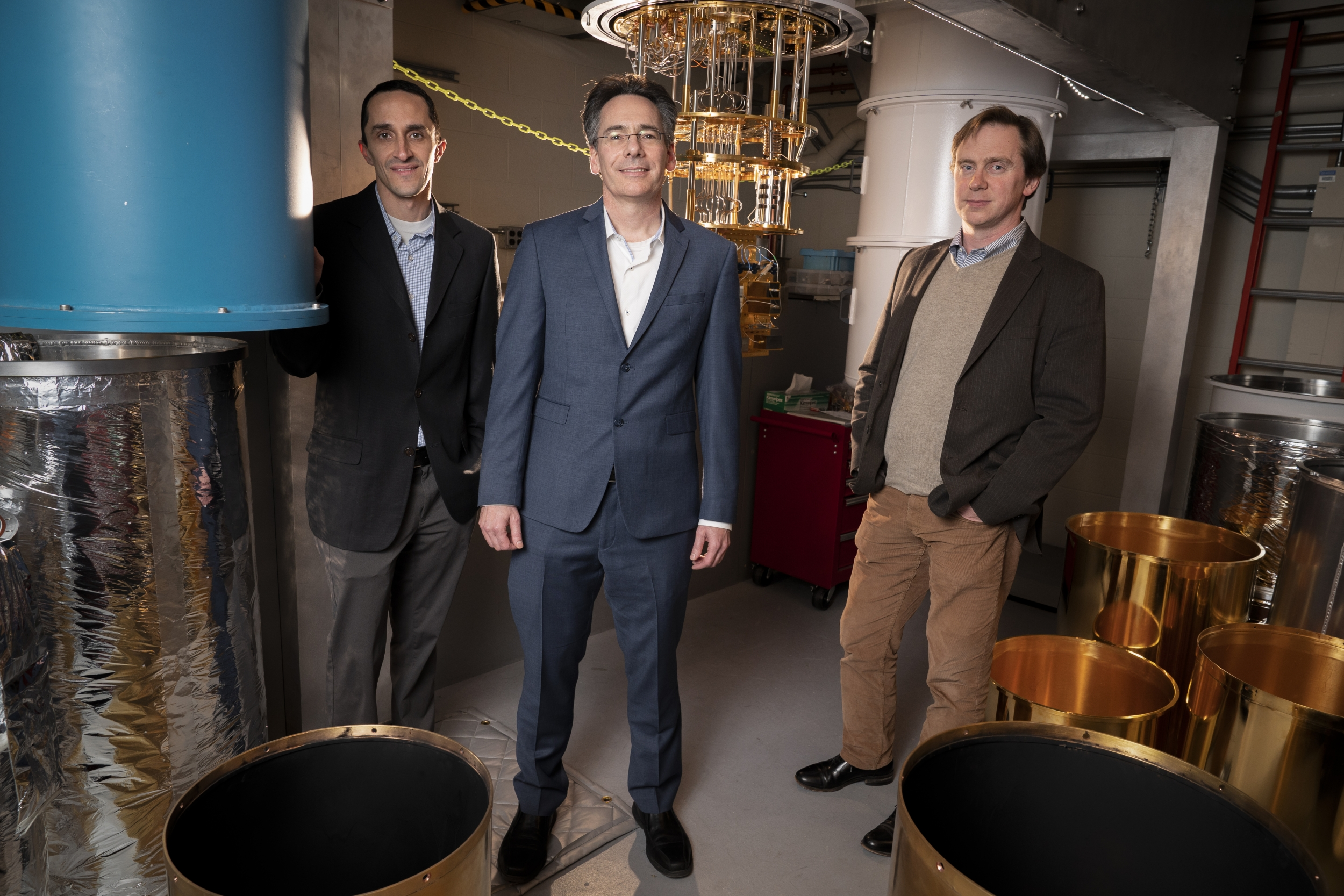 Three researchers in the quantum research laboratory