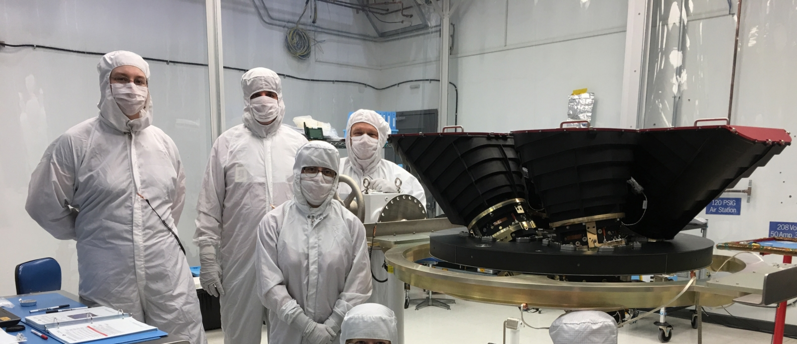 Staff from the Systems Engineering Group with the four wide-field cameras for the Transiting Exoplanet Survey Satellite (TESS).