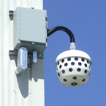 The Immersive Imaging System camera installed on the corner of a building.