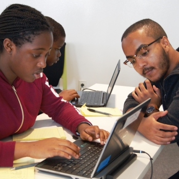 Eyassu Shimelis helps a student work through her code. Photo: Madelaine Millar