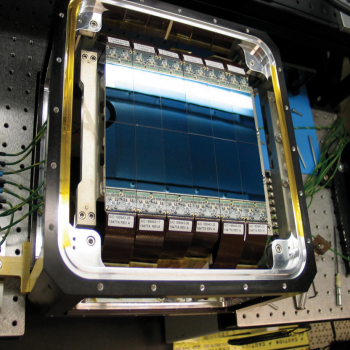 The upgraded Space Surveillance Telescope camera contains 12 charge-coupled devices developed by Lincoln Laboratory researchers. The devices are integrated into a precision dewar, above, to create the array for the telescope's focal surface.
