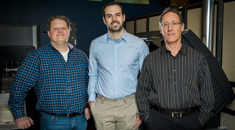 Peter Carr, left, and David Walsh, center, worked with David Scott, right, manager of Lincoln Laboratory's makerspace, the Technology Office Innovation Laboratory, to create a variety of functional devices.