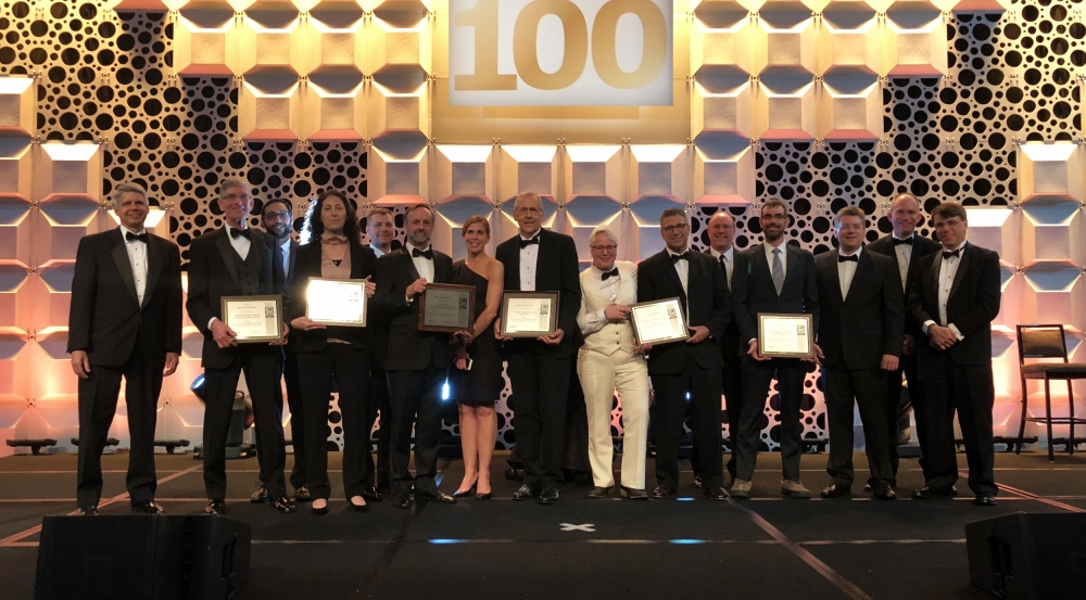 The principal researchers of Lincoln Laboratory's ten finalists for R&D 100 Awards are seen here with Lincoln Laboratory Director Eric Evans, far left. The principal researchers for the six winning technologies display their award plaques.