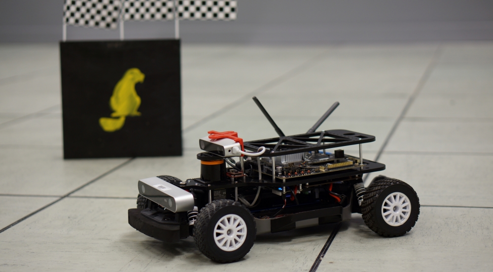 Students in the Autonomous RACECAR  Grand Prix course program the software to control the camera, lidar, sensors, and embedded processing for the robot pictured.