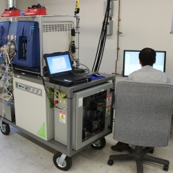 The ultra-sensitive vapor detection system during its first-ever field deployment at Hanscom Air Force Base. Sitting at the operator's station is Ta-Hsuan Ong, staff scientist and technical lead on the project.