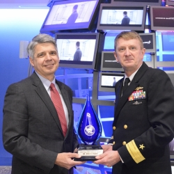 Eric Evans, director of Lincoln Laboratory, left, receives the Aegis Ballistic Missile Defense Pathfinder Award from Rear Admiral Johnny Wolfe.