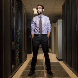 Vijay Gadepally stands in the supercomputing center