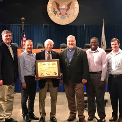 Five industry group representatives attended the 2019 Friends and Partners of Aviation Weather meeting to award James Evans (center) the third annual Aviation and Space Operations Weather Prize.