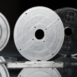 three disc-shaped microfluidic device that were 3D printed
