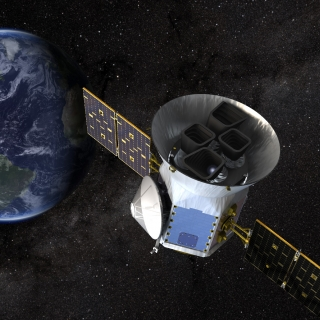 Illustration of NASA's Transiting Exoplanet Survey Satellite (TESS) at work. Credit: NASA's Goddard Space Flight Center