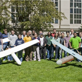 Photo of MIT students with UAVs they designed and built