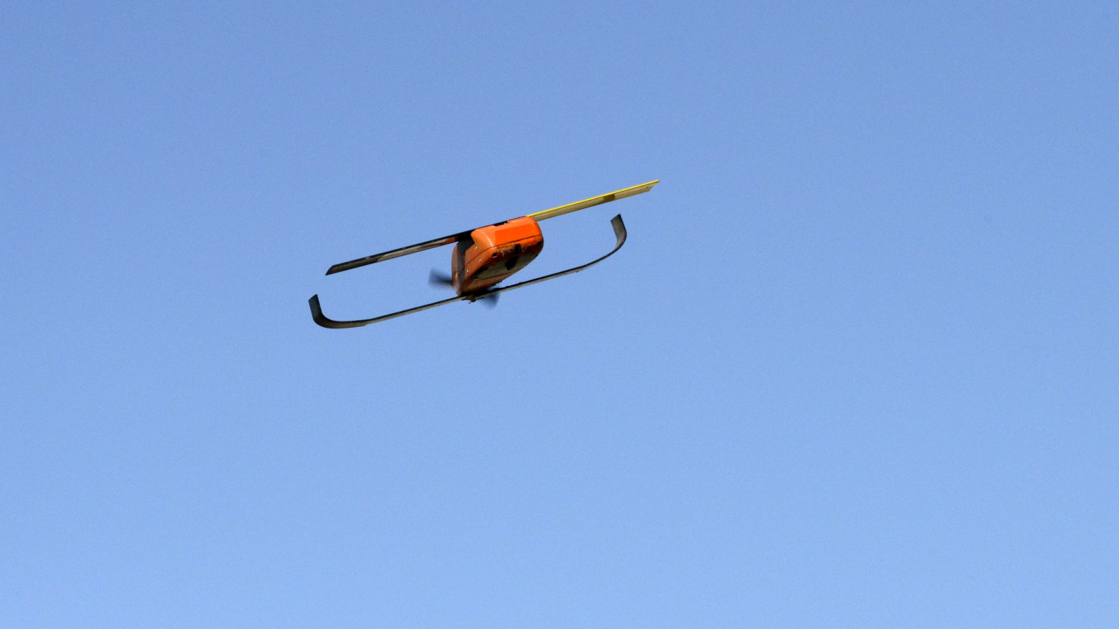 This miniature unmanned aerial vehicle is capable of autonomous navigation, including coordinated maneuvering within a large group of autonomous UAS.