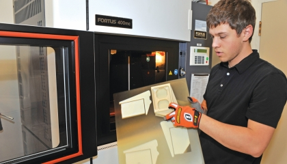 A fused deposition modeling production system in the Rapid Hardware Integration Facility enables staff to build customized thermoplastic parts for prototype systems.