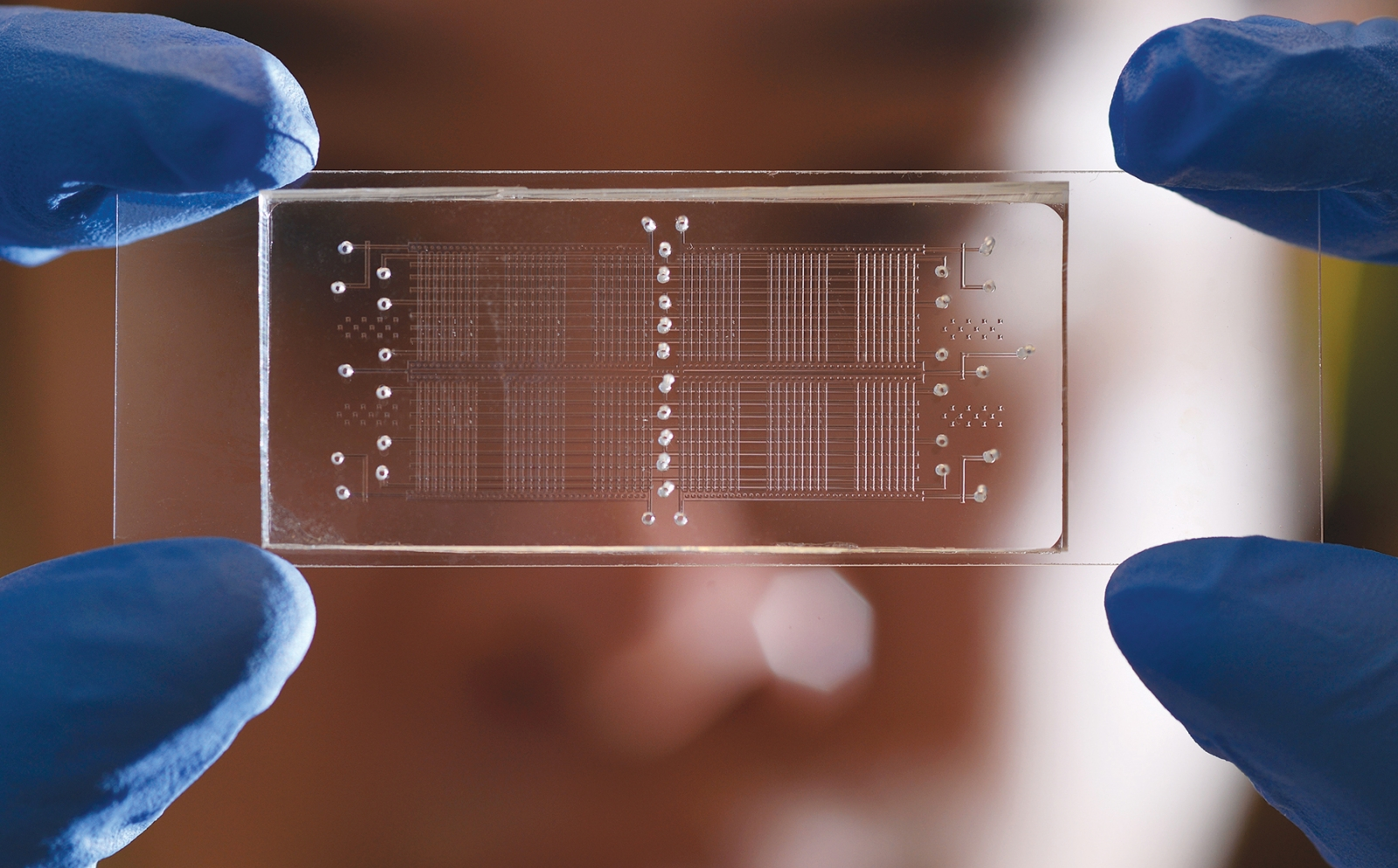 A microfluidic device that performs 96 biochemical reactions