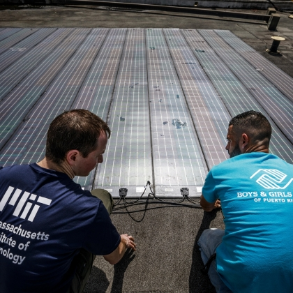 Erik Limpaecher, left, leader of the Energy Systems Group and a co-author on the report, is shown helping to install solar panels for a water purification system at the Boys and Girls Clubs of Puerto Rico in 2017. Photo: Lorenzo Moscia