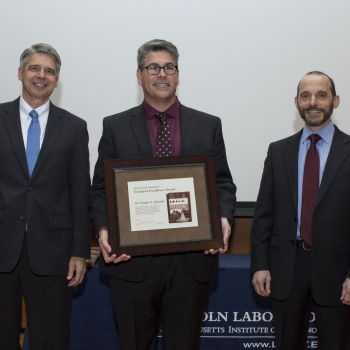 Eric Evans, left, Director of Lincoln Laboratory, presented Douglas Reynolds, center, with his award; Marc Zissman, right, Associate Head, Cyber Security and Information Sciences Division, introduced Reynolds at the awards ceremony. Photo: Glen Cooper