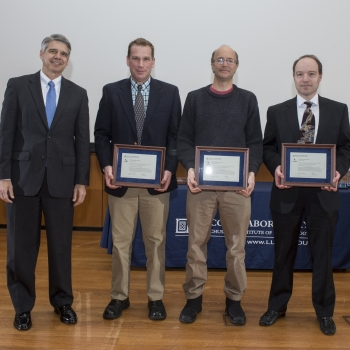 Eric Evans, left, presented the 2016 Best Paper Award to authors, left to right, Shaun Berry, Todd Thorsen, and Jakub Kedzierski. Coauthors Kevin Meng and Rafmag Cabrera were unable to attend the ceremony. Photo: Glen Cooper