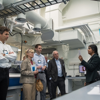 Lalitha Parameswaran of the Laboratory's Chemical, Microsystem, and Nanoscale Technologies Group explains some of the capabilities of the Defense Fabric Discovery Center to guests at the center's opening day event.