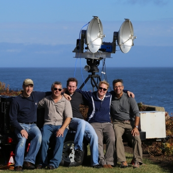 Lincoln Laboratory researchers are pictured with the front end of the polarimetric radar they assembled largely from commercial off-the-shelf components. They used the radar to collect a sea clutter dataset on the coast of Massachusetts' Cape Ann.