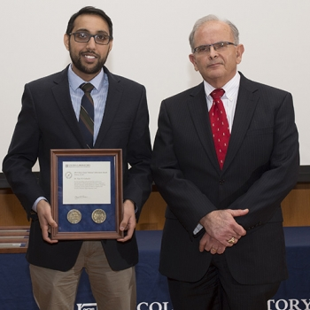 Vijay Gadepally, left, with his citation, is joined by David Martinez, Associate Head, Cyber Security and Information Sciences Division, who introduced Gadepally at the awards ceremony. Photo: Glen Cooper