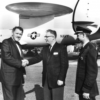 AN/APS-70 AEW radar mounted on a WV-2E aircraft. The 30-foot antenna was the largest airborne antenna of its day. Pictured in the center is Jerome Freedman of Lincoln Laboratory.