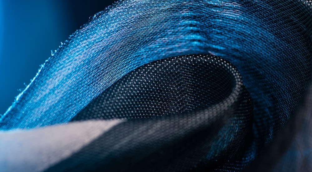 Unique fabrics woven with microstructured polymer fibers and containing microelectronics will be transitioned into integrated systems at the Defense Fabric Discovery Center.