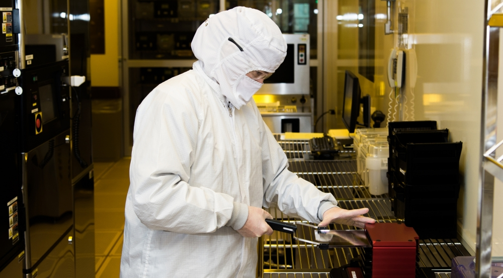 A staff member fabricates a wafer in the Microelectronics Laboratory.