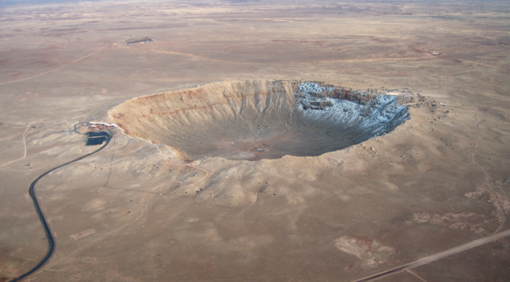 The Meteor Crater near Winslow, Arizona, is approximately 3,397 feet (0.75 miles) in diameter and 558 feet deep. It resulted from an asteroid impact 50,000 years ago. Photo courtesy of NASA