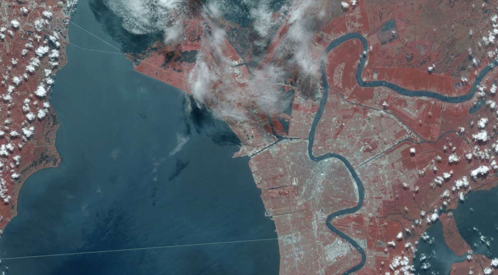 Above is a portion of a 21 July 2002 scan of New Orleans; the image has been color-processed to reflect data collected from multiple bands, including infrared, which shows up as the bright red.