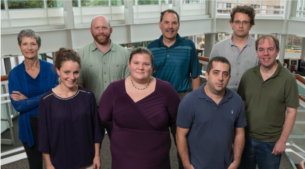 Ricke worked with the bioinformatics team to develop the IdPrism system: back row, Martha Petrovick, Philip Fremont-Smith, Darrell Ricke, and James Watkins; front row, Mallory Clark, Sara Stankiewicz, Adam Michaleas, and Thomas White. Photo: Glen Cooper