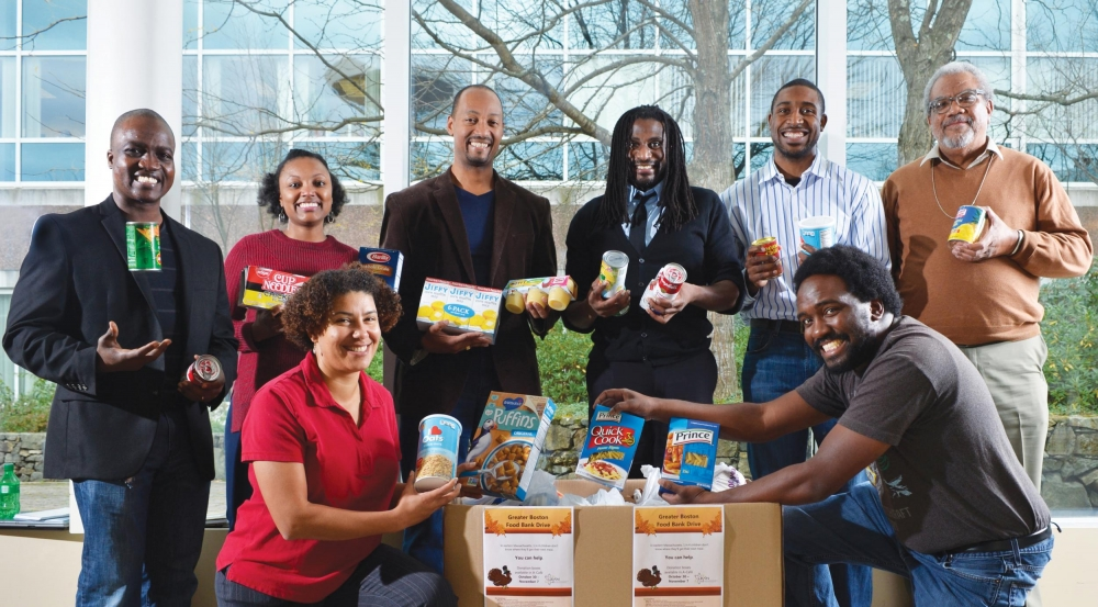 Some volunteers from the Lincoln Employees' African American Network (LEAN) gather donations prior to delivering nonperishable goods to the Greater Boston Food Bank.