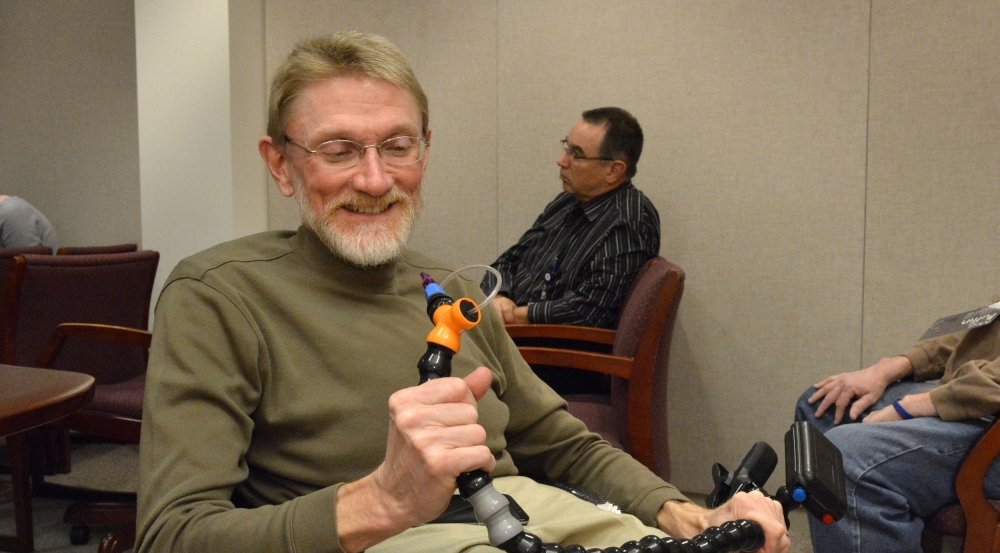 A LED committee member, Gary Brendel, helped organize a seminar for employees to learn more about the Puffin, a wireless sip-and-puff joystick controller designed by MIT students for a client with cerebral palsy.