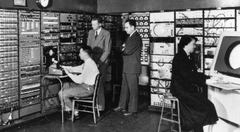 The Whirlwind computer console room in MIT's Barta Building in 1950; Jay Forrester, second from left, and Robert Everett, second from right.