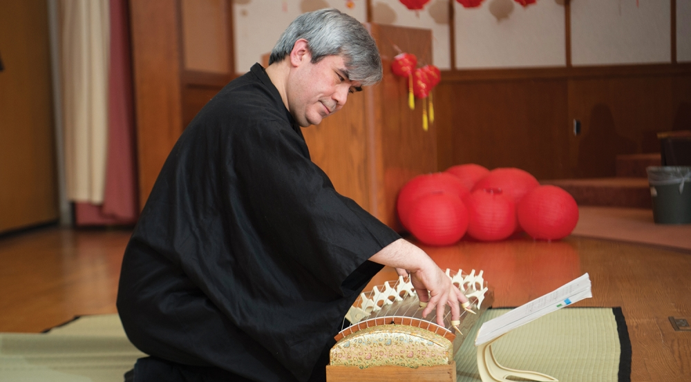 Laboratory employee Charles Hughes performed Japanese folk music on the koto, a traditional stringed instrument, at the Lunar New Year celebration.