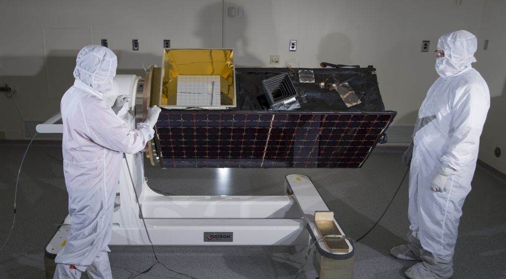 Engineers inspect SensorSat prior to thermal-vacuum testing that validated the system's endurance against the expected launch and space conditions.