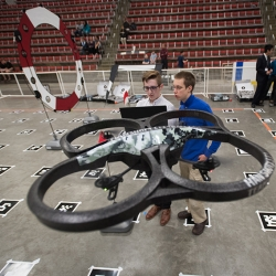 Students from the unmanned aerial vehicle course race their quadcopter through the obstacle course.