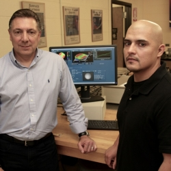 Dr. Nicholas Massa and student Gerald Gagnon in the Optics and Photonics laboratory at STCC.