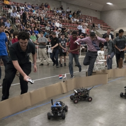 Students in the Beaver Works Summer Institute's Autonomous RACECAR course follow their cars during the program's final race. Photo: Glen Cooper