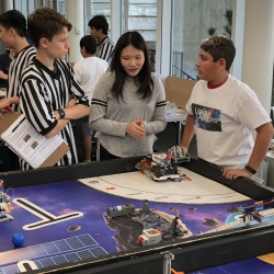 At a scrimmage in the main cafeteria, FIRST LEGO League teams (which consist of fourth to eighth graders) show each other their robots. They built the robots as part of the Robotics Outreach at Lincoln Laboratory program. Photo: David Radue