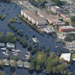 aerial image showing a neighborhood flooded by a natural disaster.