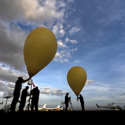 Photo of researchers launching the weather balloons