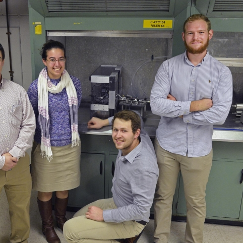 WPI students, with the guidance of their Lincoln Laboratory mentor (left) developed a liquid-propellant propulsion system for picosatellites for their Major Qualifying Project.