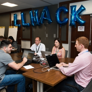 During the two-day hackathon, staff were challenged to quickly train and test machine learning algorithms to detect fake media content. Photo: Nicole Fandel