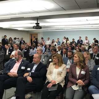 Attendees, hailing from startups, venture capital companies, DoD organizations, and non-profits, packed the room to hear two panel discussions before breakout sessions in the Venture Café.