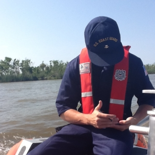 A U.S. Coast Guard responder offshore is able to access real-time information from NICS' onshore computers on a mobile device. Photo: Amna Greaves