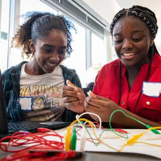 Young girls build a closed circuit during a G.I.R.L. workshop