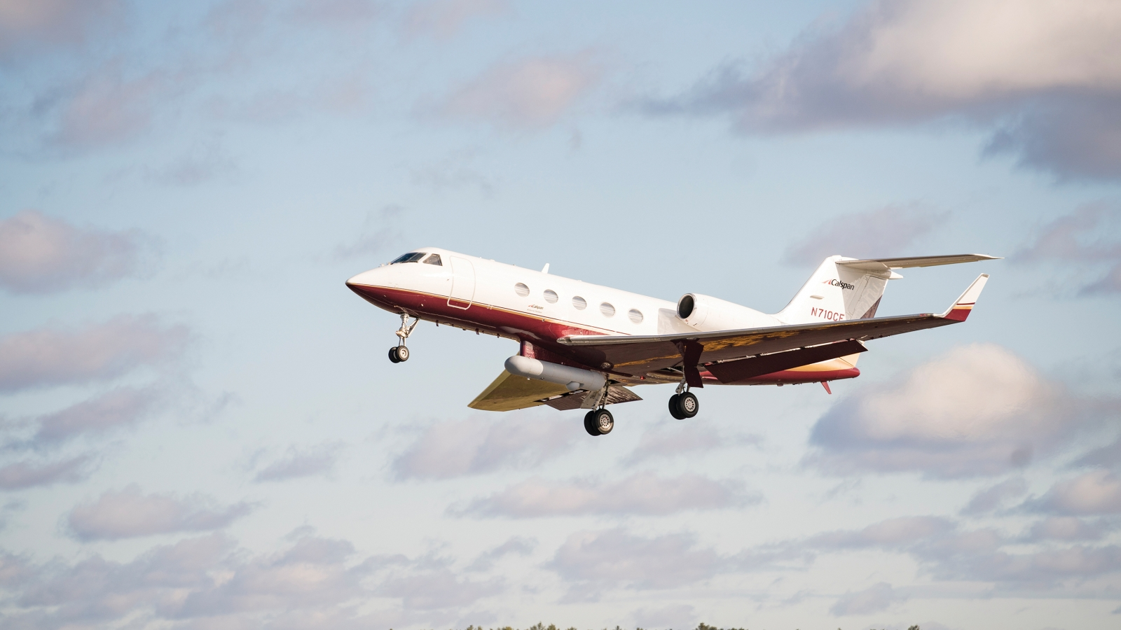 A Gulfstream III aircraft is shown with a PACECR communications pod attached.