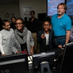 Three students direct virtual planes down the runway with the help of Brad Crowe. Photo: Nicole Fandel