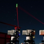 A photo of three lasers being transmitted from ground modules