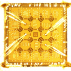 A photo of a superconducting quantum hip with 16 qubits.